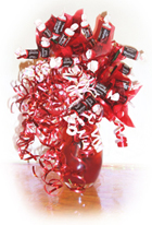 Red lovely vase with tootsie rolls